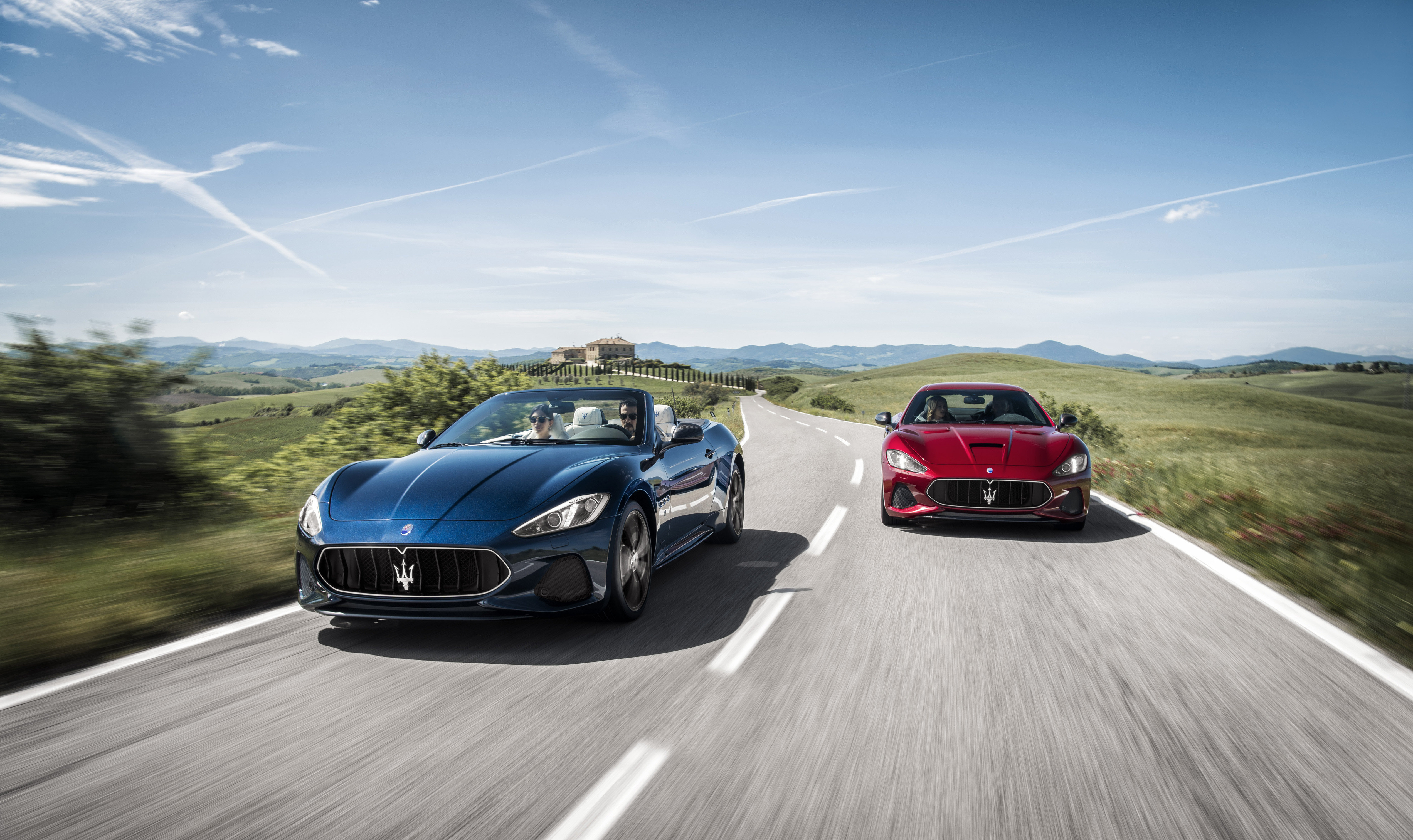Blue and red maserati granturismo's driving down a country road in Wilkes Barre PA