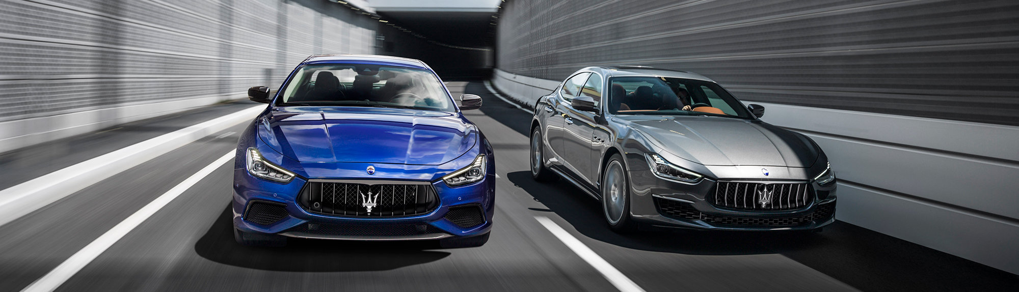 blue and silver maserati ghibli racing down wilkes-barre blvd
