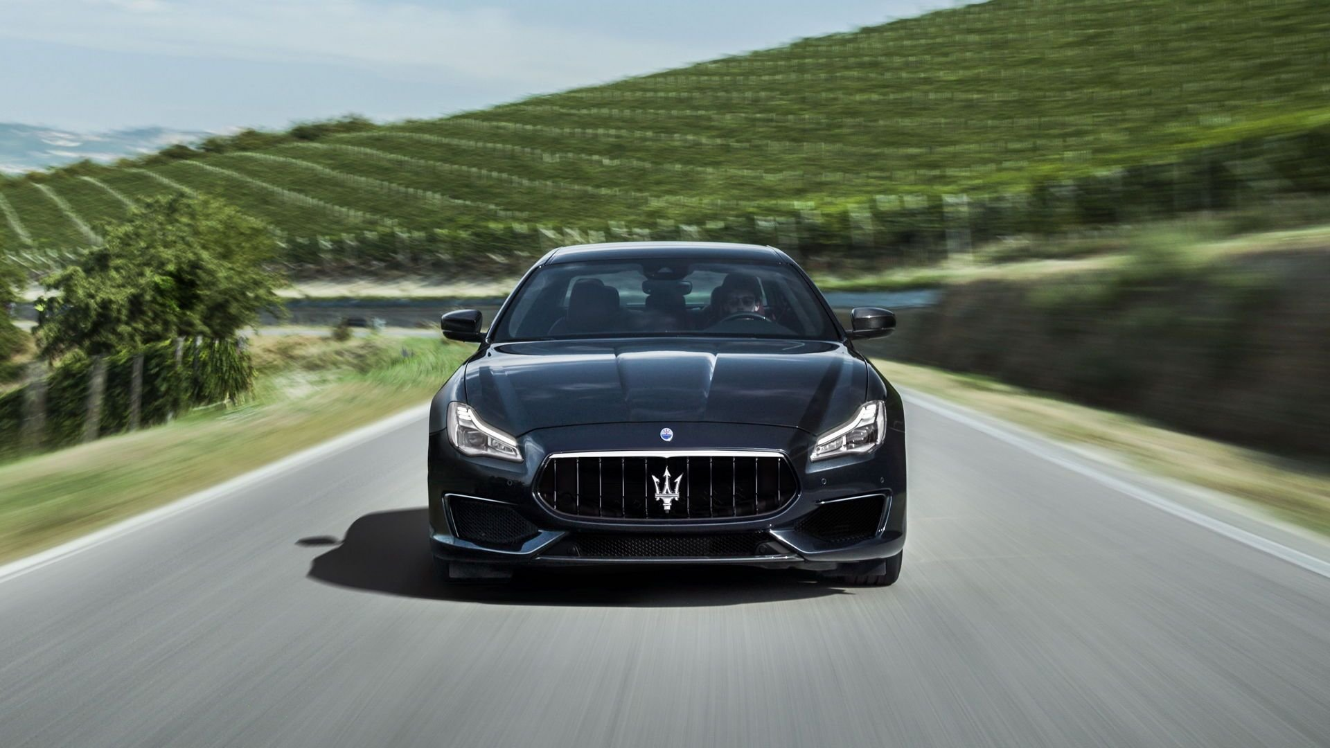black 2018 maserati quattroporte racing down wilkes-barre blvd.