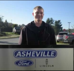 Finance Manager Jeremi Comolli in Managers at Asheville Ford