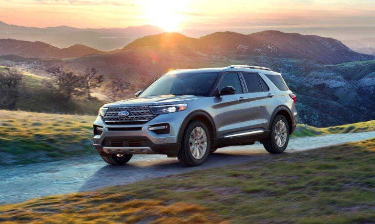 2021 Ford Explorer driving in the countryside at sunset