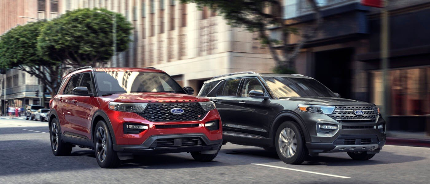 Red & Blue 2021 Ford Explorer Driving Side by Side