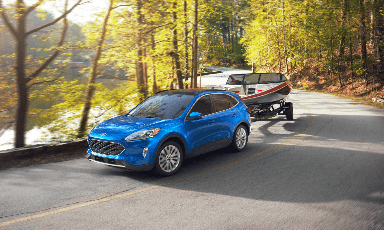 Blue 2020 Ford Escape Towing a Boat