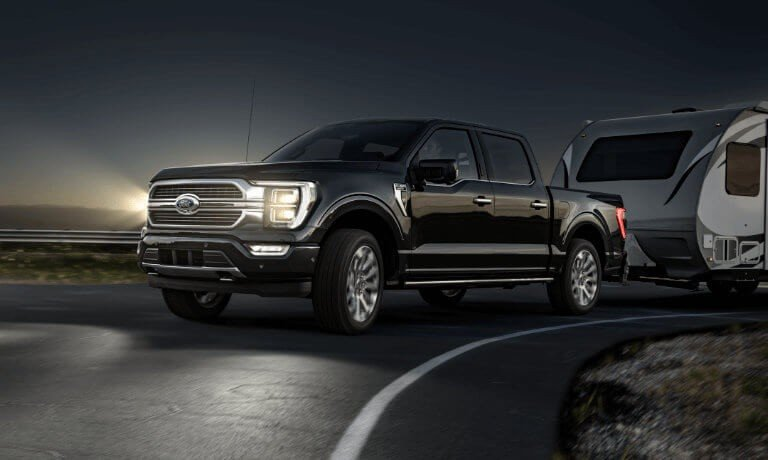 2021 Ford F150 Exterior Driving At Night While Pulling Camper