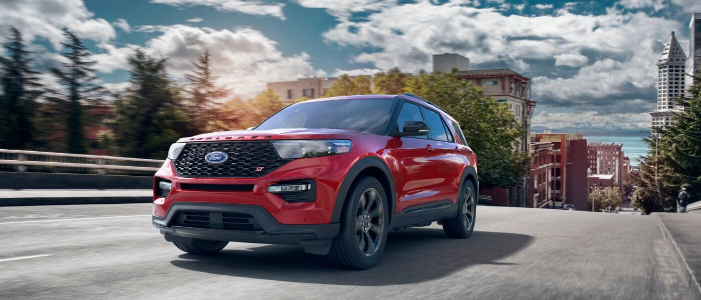 2021 Red Ford Explorer Driving Over a Bridge