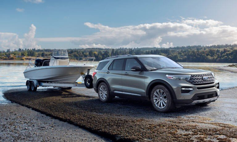 2021 Ford Explorer towing a boat by the lake