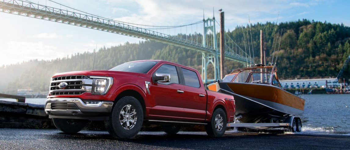 Red 2021 Ford F-150 Towing a Boat out of Water