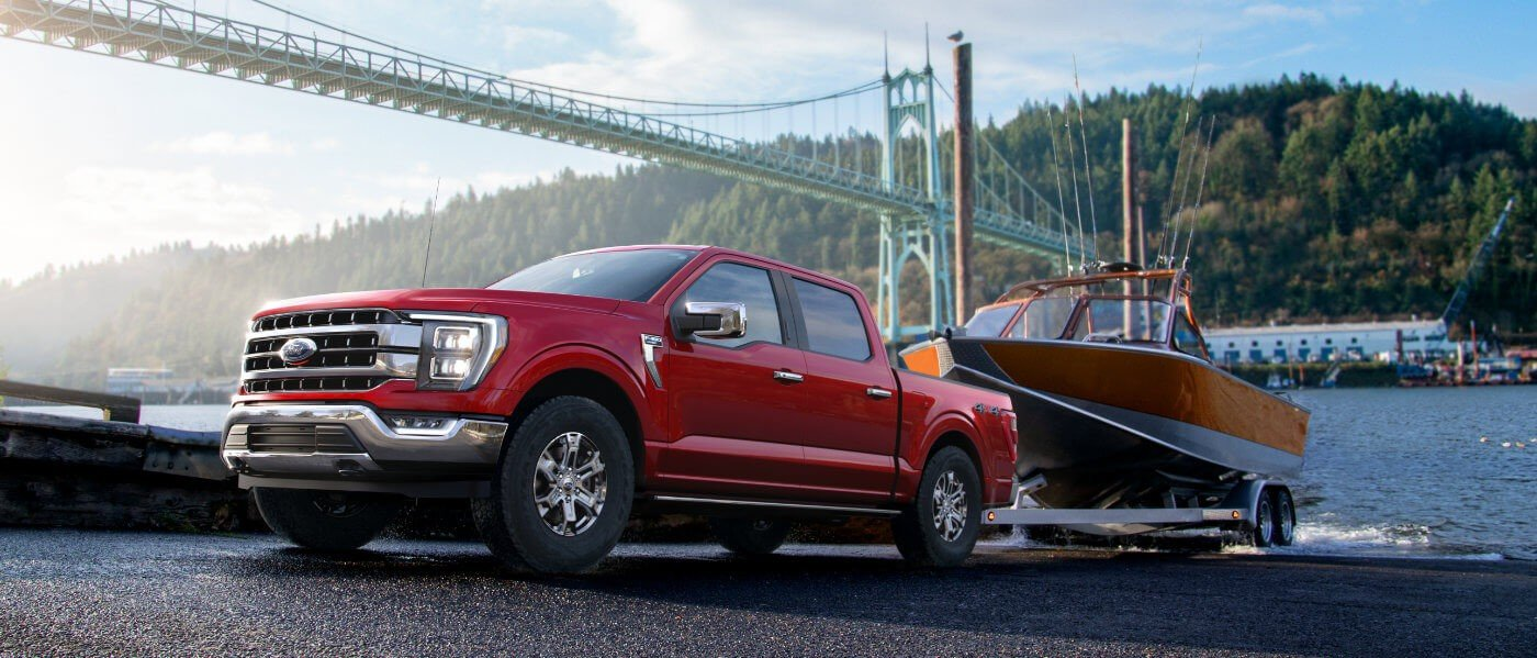 2021 Red Ford F-150 Towing a Boat out of Water
