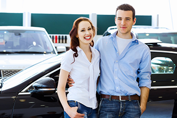 Couple who just purchased a used car from Blue Ridge Autos in Kansas City MO