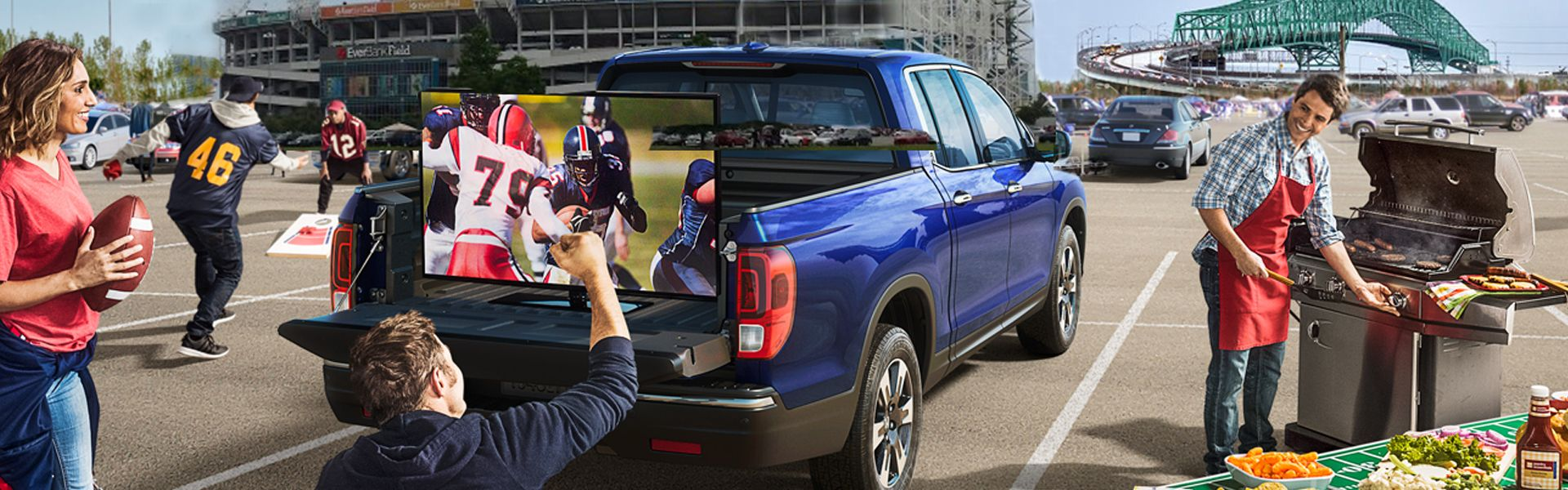 Tailgate party on the back of a blue Honda Ridgeline at Everbank Stadium in Jacksonville FL