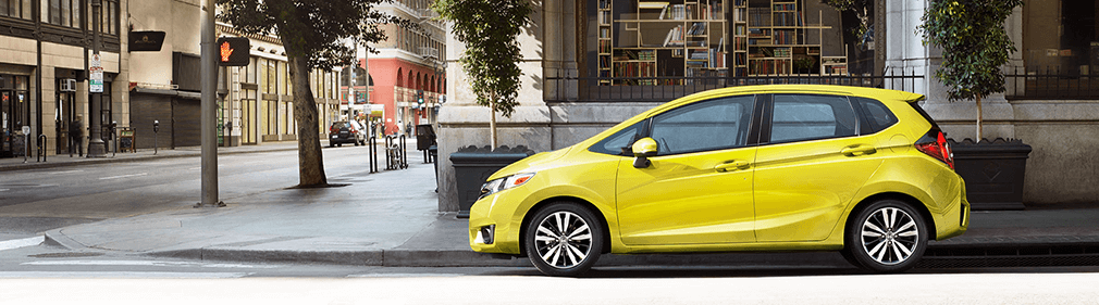 brand new yellow honda fit driving on granad st. in Lakeland FL