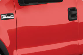 dent was fixed in the same red ford f150 truck