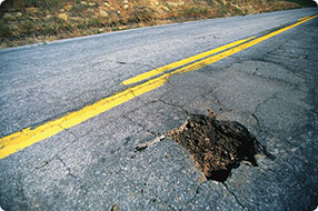 large pothole in the road that can bend your vehicles rim