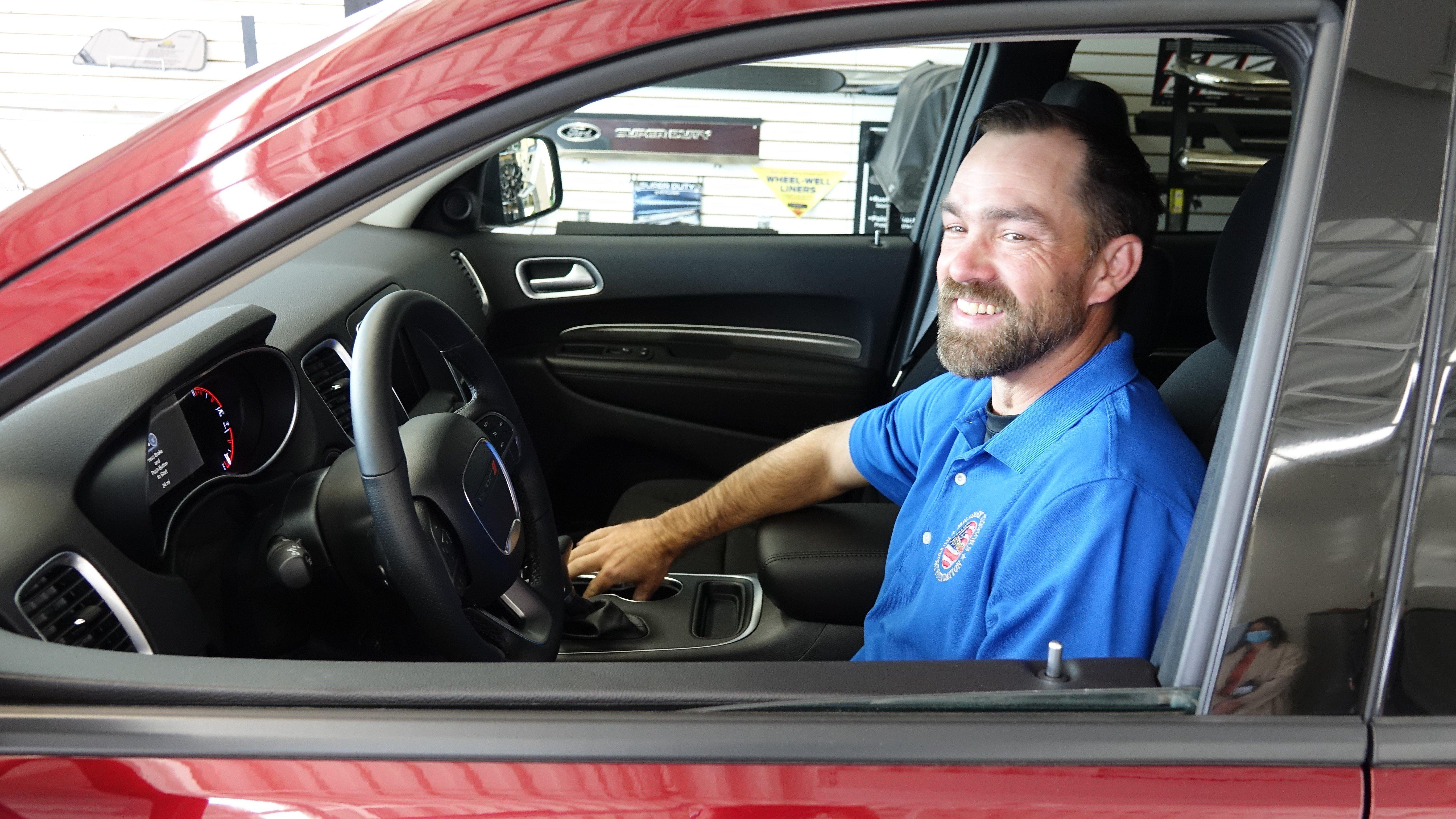 Clint Romesha in a new Dodge Durango