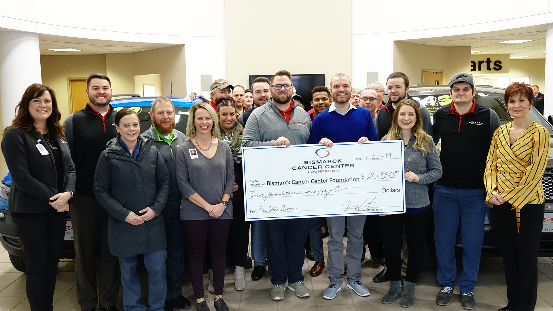 the Eide Chrysler team with a donation to the Bismarck Cancer Center