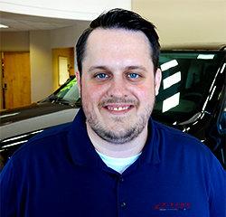 Oil Change Advisor Ryan Wynne in Service at Eide Chrysler