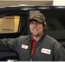 Quick Lube Technician Aric Heinert in Service at Eide Chrysler