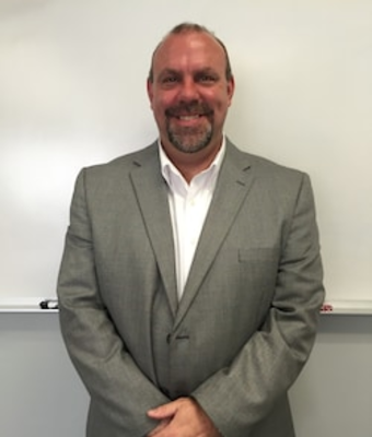 Dealer / General Manager Gary Edwards in Primary Department at Chuck Colvin Nissan