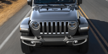 The new 2021 Jeep Wrangler 4xe driving in Pine City