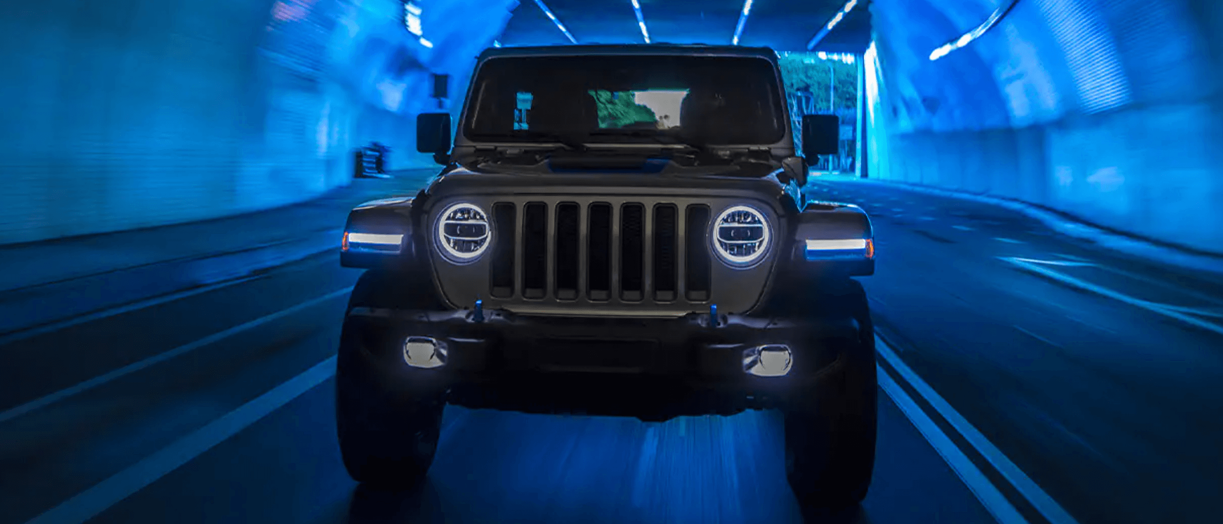 The new 2021 Jeep Wrangler 4xe driving through a tunnel
