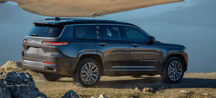 The new 2021 Jeep Grand Cherokee L parked near a lake.