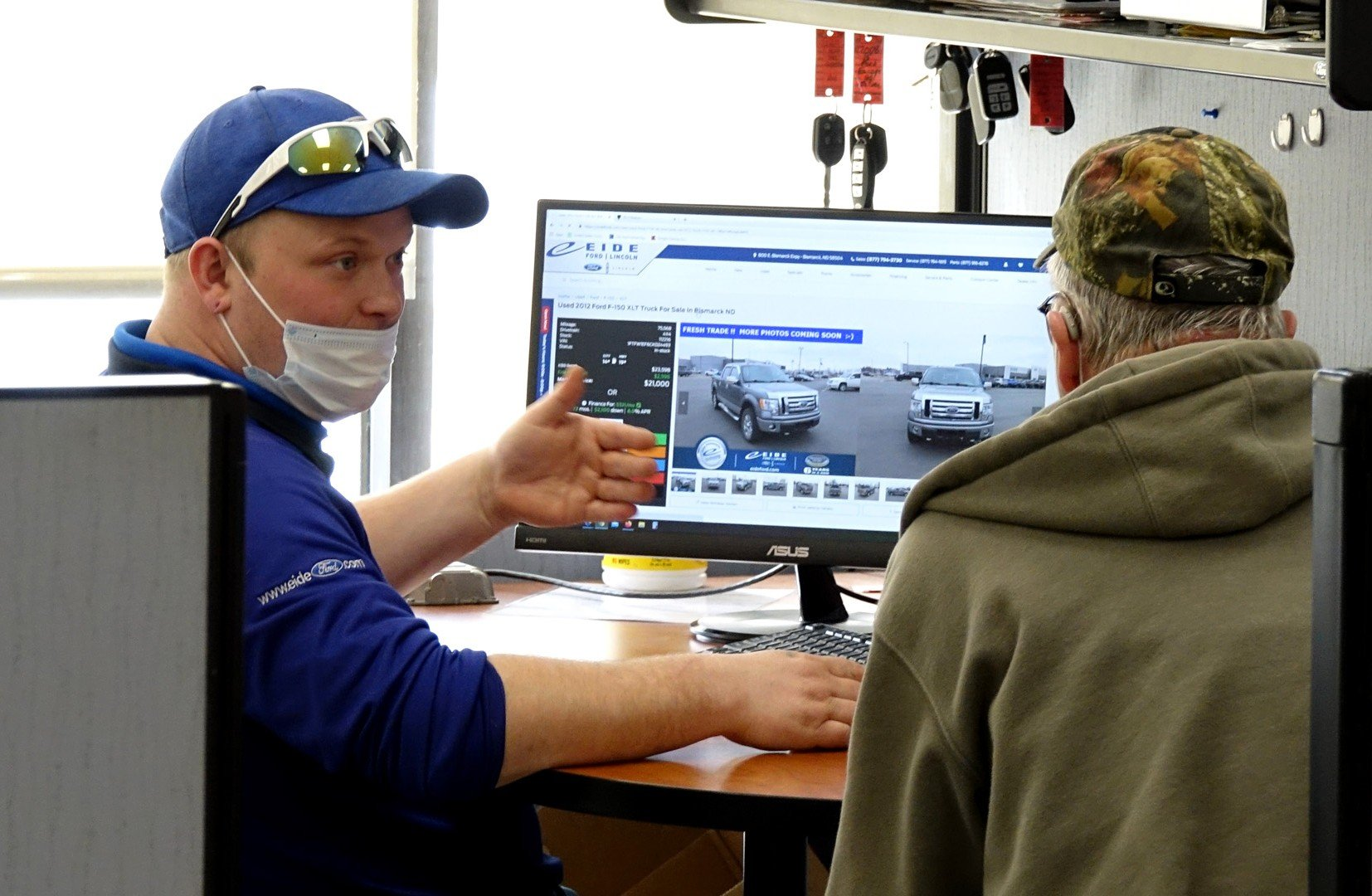 Eide Ford sales staff helping a Bismarck customer