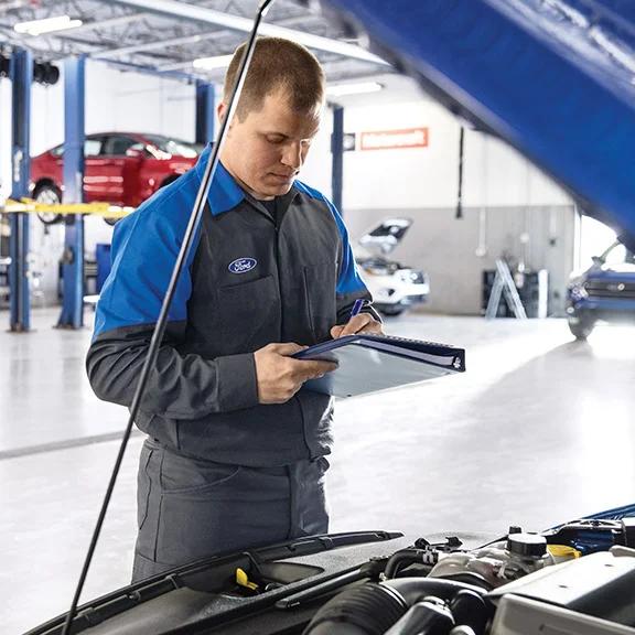 technician inspecting vehicle