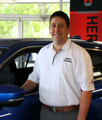 CFO Brandon Oakes in Office & Support Team at Oakes Mitsubishi