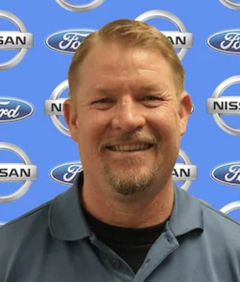 Quick Lane Manager Jon Hallquist in Service at Chuck Colvin Ford