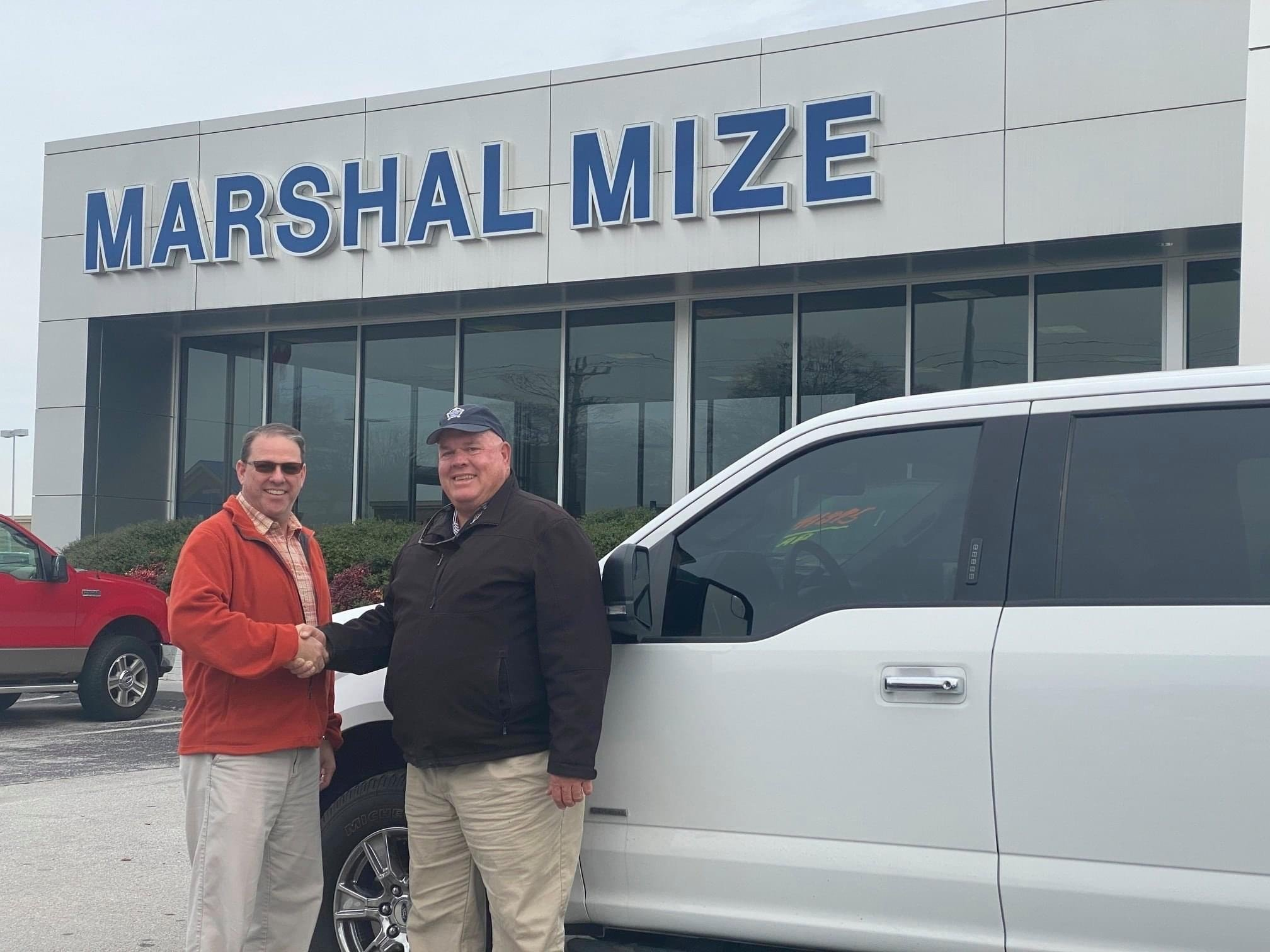 Buying a white truck at Marshal Mize