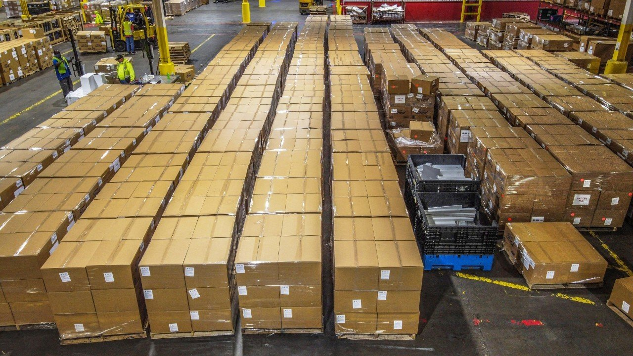 Rows of boxes filled with personal protective equipment made by Ford wait to be shipped from Ford subsidiary Troy Design & Manufacturing. (Image Courtesy of Ford Motor Company)