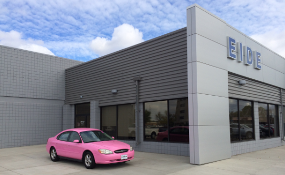 pink Ford Taurus in front of Eide Ford in Bismarck