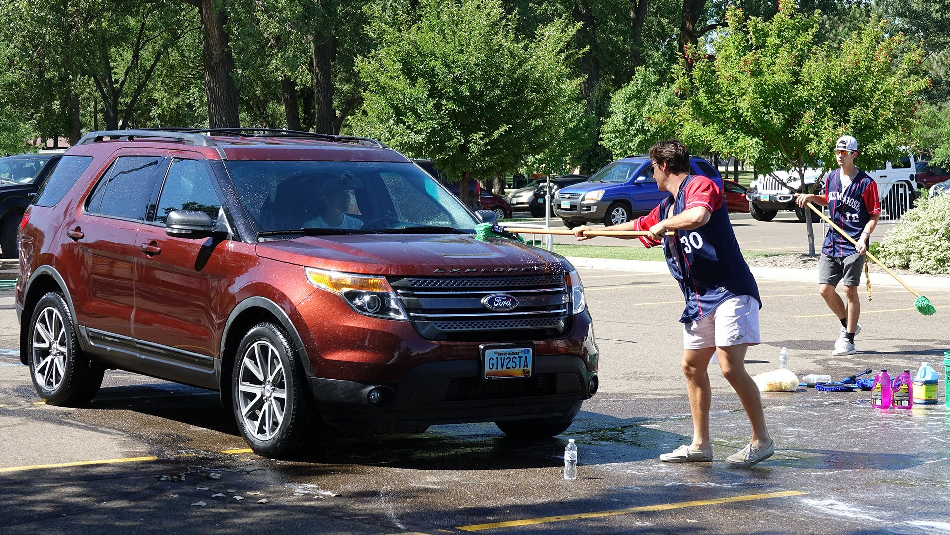 Eide Ford and Eide Chrysler washed cars with the Bismarck Larks and Bobcats to raise money for public schools.