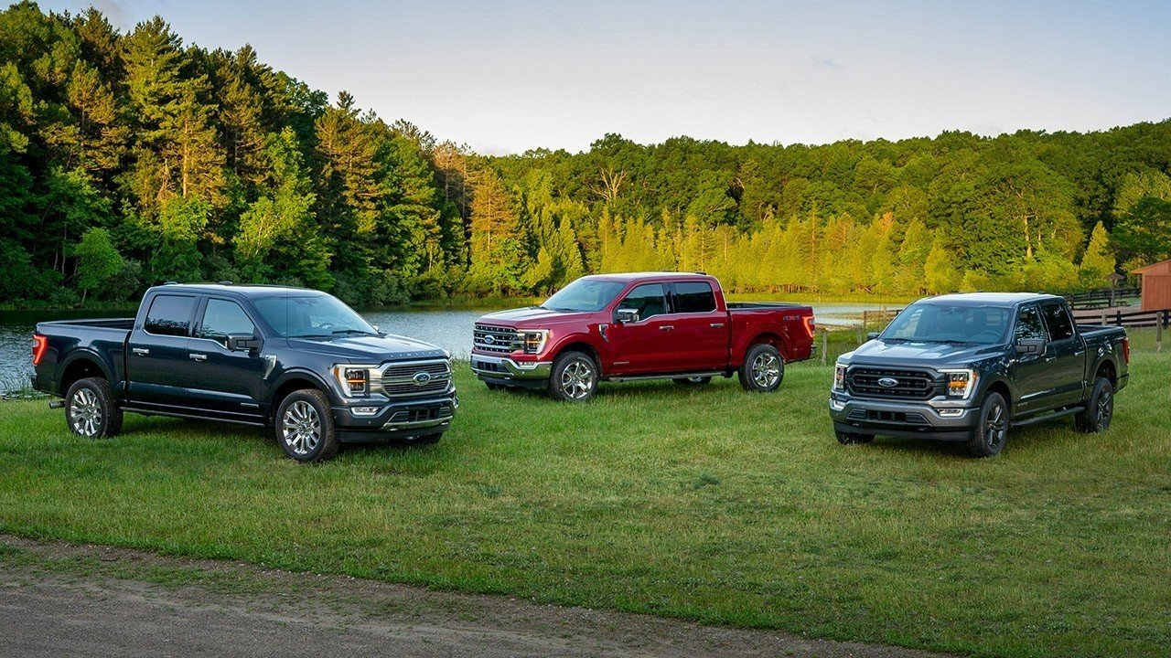 3 Ford F-150s by a river