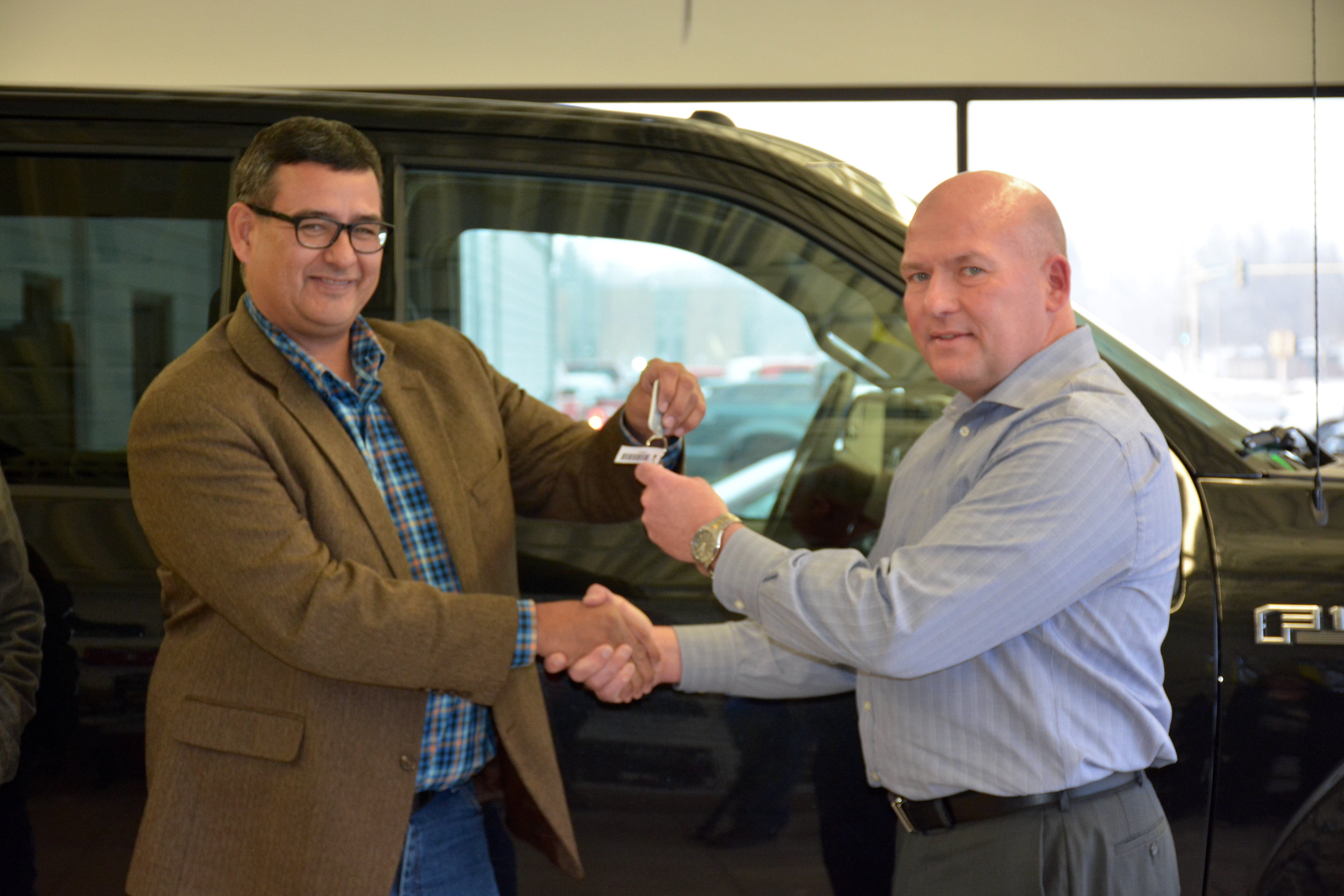 MHA Tribal Chairman Mark Fox and Eide Ford General Sales Manager Casey Neuwmann