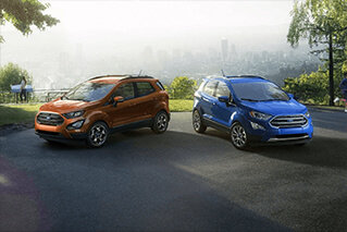 brand new 2018 blue and orange ford ecosports parked next to each other