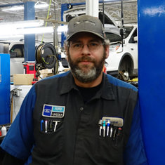 Lube Rack Technician Ryan Rose in Service at Eide Ford Lincoln