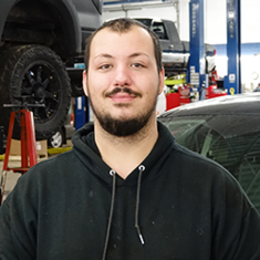 TECHNICIAN Sheldon Baumgartner in Service at Eide Ford Lincoln