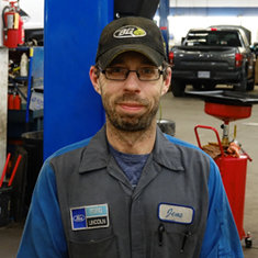 Lube Rack Technician Jens Bell in Service at Eide Ford Lincoln