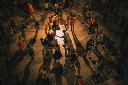 Couples out on the dance floor and enjoying their evening by dancing the night away.