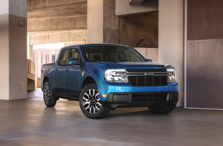 The all-new 2022 Ford Maverick in blue parked inside a parking structure.