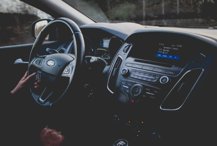 The black dashboard of a new Ford SUV.