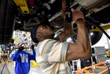 Ford employee assembling 2020 Ford Explorer