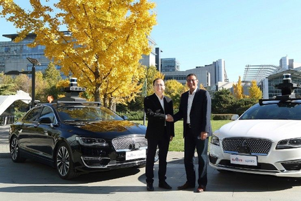 Sherif Marakby, president and CEO of Ford Autonomous Vehicles LLC and Zhenyu Li, Vice President and General Manager of Baidu's Intelligent Driving Gro