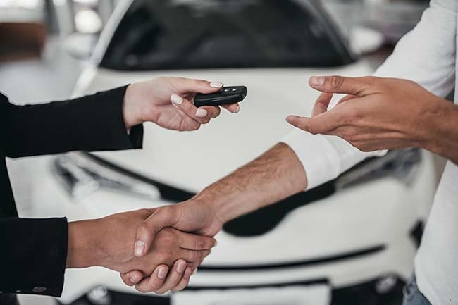 Shaking hands in a manager car deal