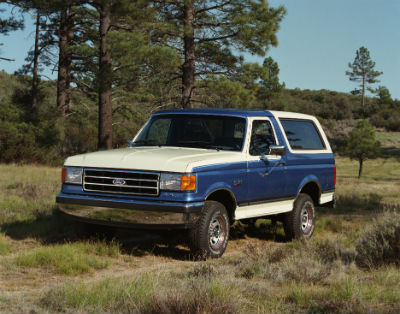 1989 Ford Bronco exterior front fascia and drivers side parked in grass