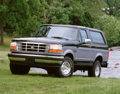 1995 Ford Bronco exterior front fascia and drivers side parked in grass by lake