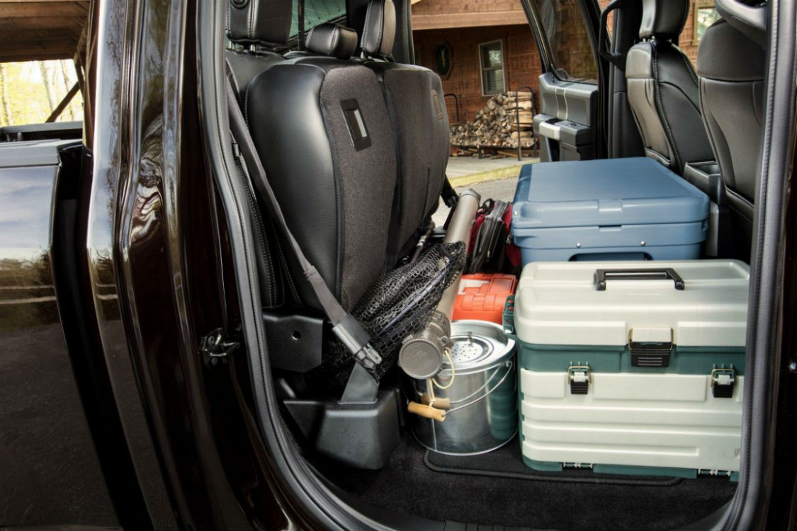 Side view of the 2018 Ford F-150's rear seat folded up and filled with cargo