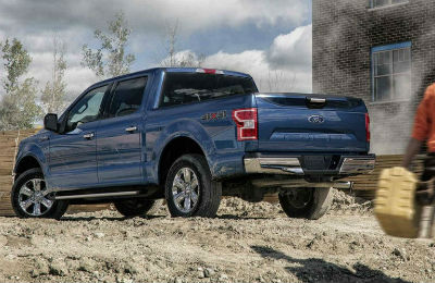 2018 Ford F-150 exterior back fascia and drivers side next to brick building
