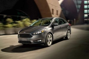 2018 Ford Focus sedan exterior front fascia and drivers side going fast on road
